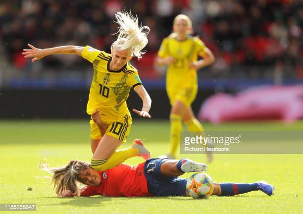 Sofia Jakobsson of Sweden is challenged by Javiera Toro of Chile during the 2019 FIFA Women's World Cup France group F match between Chile and Sweden...