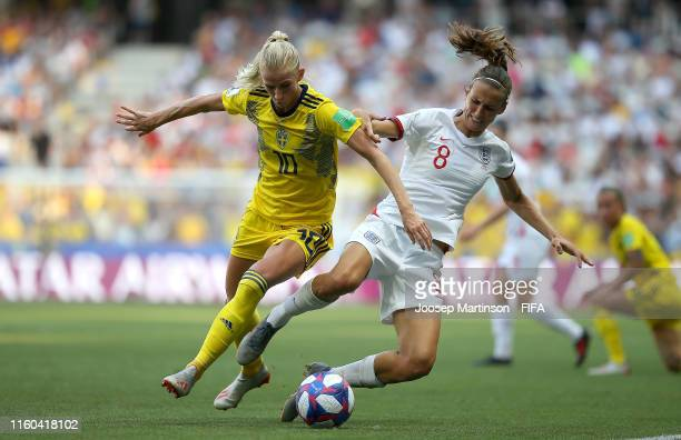 Sofia Jakobsson of Sweden is challenged by Jill Scott of England during the 2019 FIFA Women's World Cup France 3rd Place Match match between England...