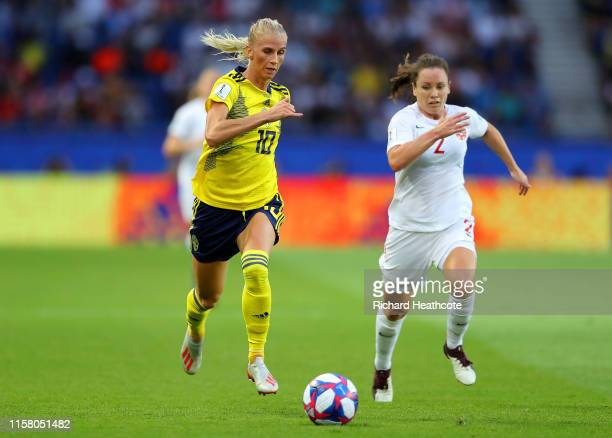 Sofia Jakobsson of Sweden runs with the ball under pressure from Allysha Chapman of Canada during the 2019 FIFA Women's World Cup France Round Of 16...