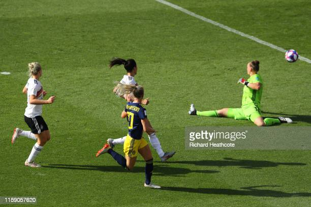Sofia Jakobsson of Sweden scores her team's first goal past Almuth Schult of Germany during the 2019 FIFA Women's World Cup France Quarter Final...