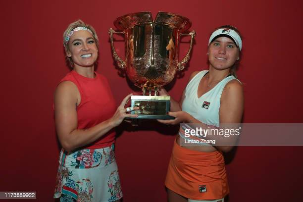 Sofia Kenin and Bethanie MattekSands of the United States celebrate with trophy during the Award Ceremony after winning the Women's doubles final...