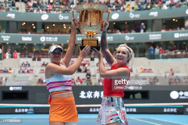 Sofia Kenin and Bethanie Mattek-Sands of the United States celebrate with trophy during the Award Ceremony after winning the Women's doubles final...