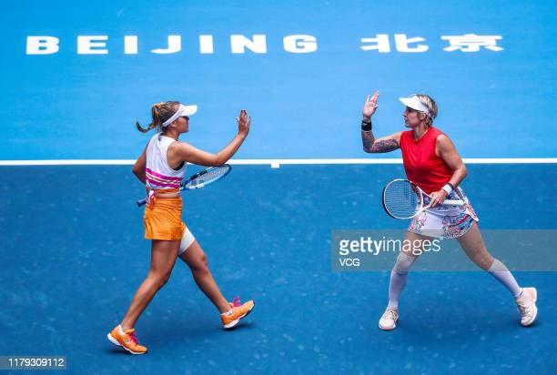 Sofia Kenin and Bethanie Mattek-Sands of the United States celebrate in the Women's Doubles final match against Jelena Ostapenko of Latvia and Dayana...