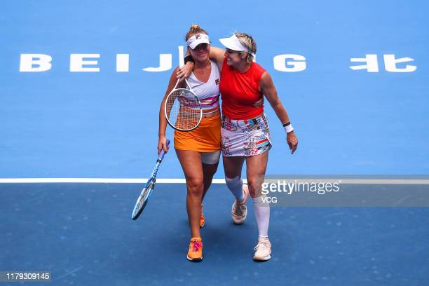 Sofia Kenin and Bethanie Mattek-Sands of the United States celebrate victory after the Women's Doubles final match against Jelena Ostapenko of Latvia...