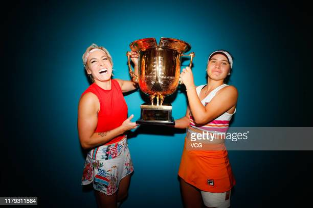 Sofia Kenin and Bethanie MattekSands of the United States pose with the champion trophy after the Women's Doubles final match against Jelena...