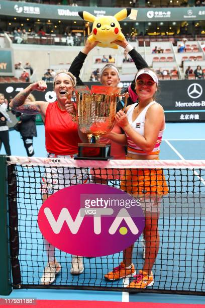 Sofia Kenin and Bethanie Mattek-Sands of the United States pose with the champion trophy after the Women's Doubles final match against Jelena...