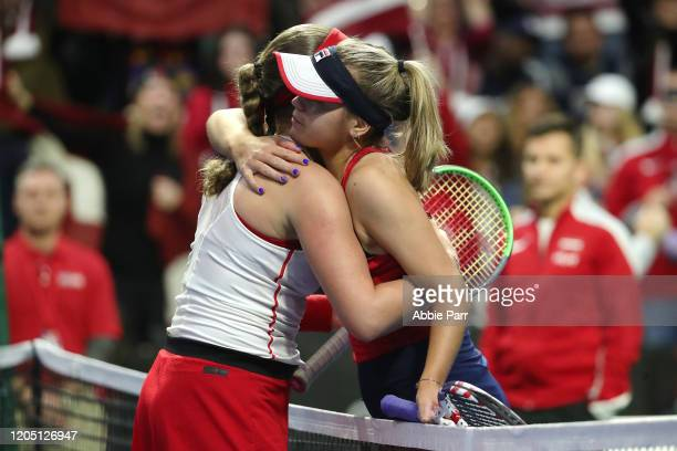 Sofia Kenin of the United States and Jelena Ostapenko of Latvia hug after Ostapenko won in three sets during the 2020 Fed Cup qualifier between USA...