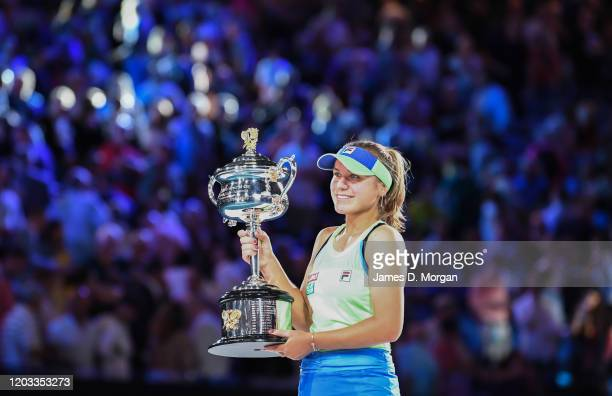 Sofia Kenin of the United States holds the Daphne Akhurst Memorial Cup after winning her Women's Singles Final match against Garbine Muguruza of...