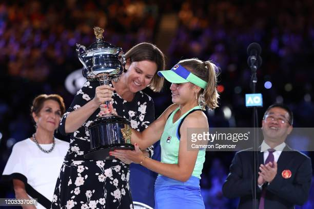 Sofia Kenin of the United States is presented with the Daphne Akhurst Memorial Cup by Lindsay Davenport after winning her Women's Singles Final match...