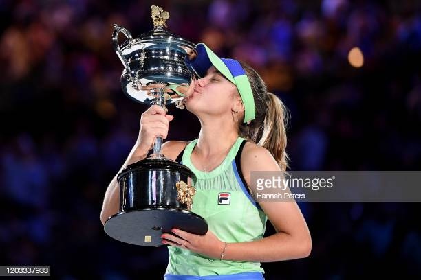 Sofia Kenin of the United States kisses the Daphne Akhurst Memorial Cup after winning her Women's Singles Final match against Garbine Muguruza of...