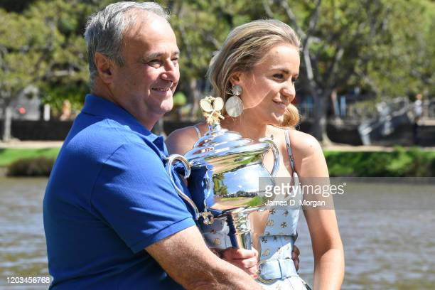 Sofia Kenin of the United States poses next to her father Alex Kenin with the Daphne Akhurst Memorial Trophy beside the Yarra River after winning the...