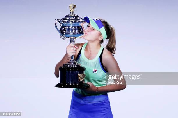Sofia Kenin of the United States poses with the Daphne Akhurst Memorial Cup after winning her Women's Singles Final match against Garbine Muguruza of...