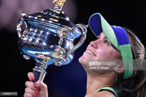 Sofia Kenin of the United States poses with the Daphne Akhurst Memorial Cup after winning her Women's SinglesFinal match against Garbine Muguruza of...