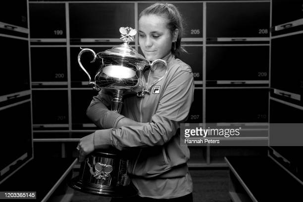 Sofia Kenin of the United States poses with the Daphne Akhurst Trophy in the locker room after winning her Women's Singles Final match against...