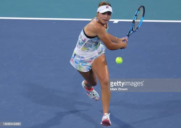 Sofia Kenin of the United States returns a shot during her singles second round match against Andrea Petkovic of Germany on Day 5 of the 2021 Miami...