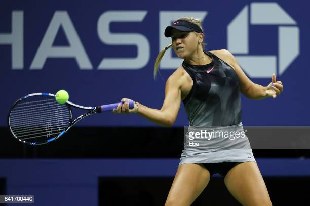 Sofia Kenin of the United States returns a shot to Maria Sharapova of Russia during their third round Women's Singles match on Day Five of the 2017...