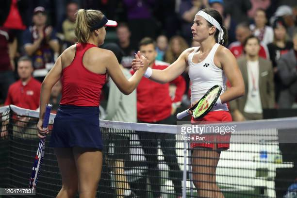 Sofia Kenin of the United States shakes hands with Anastasija Sevastova of Latvia after winning her match during the 2020 Fed Cup qualifier between...