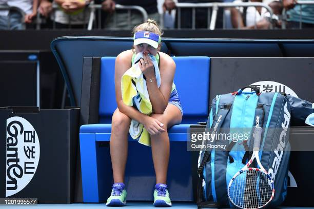 Sofia Kenin of the United States sits on the bench in tears after winning her Women's Singles fourth round match against Coco Gauff of the United...