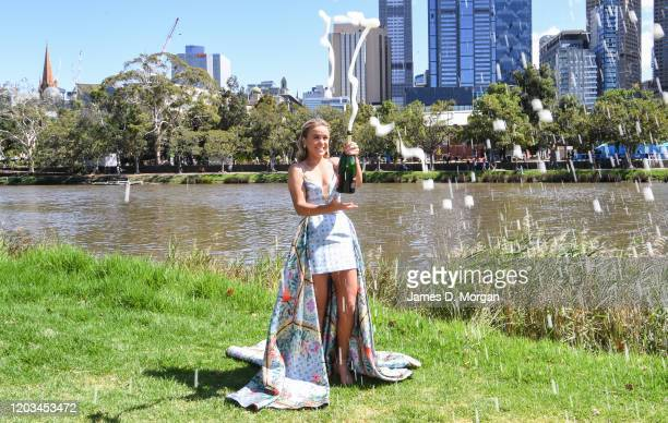 Sofia Kenin of the United States sprays a bottle of champagne beside the Yarra River after winning the 2020 Australian Open Women's Final on February...