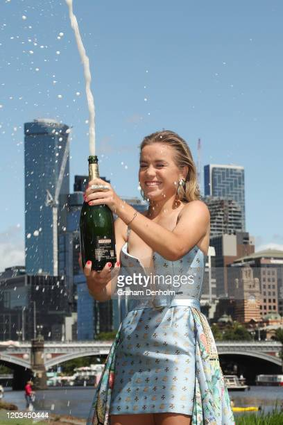 Sofia Kenin of the United States sprays champagne after winning the 2020 Australian Open Women's Final, at Yarra River Boathouse Drive on February...