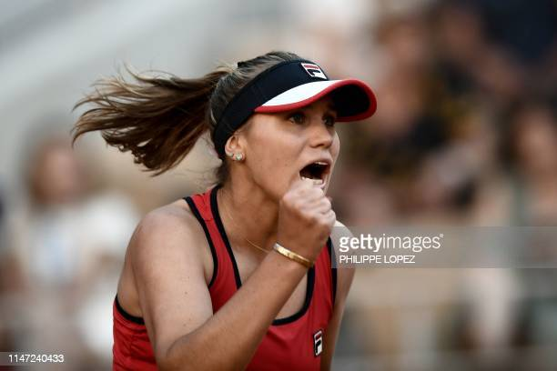 TOPSHOT Sofia Kenin of the US celebrates after winning against Serena Williams of the US during their women's singles third round match on day seven...