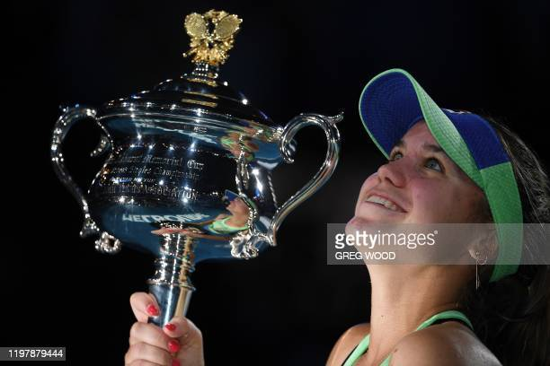 Sofia Kenin of the US poses with the trophy after winning against Spain's Garbine Muguruza in their women's singles final match on day thirteen of...