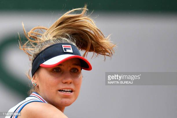 Sofia Kenin of the US reacts as she plays against Australia's Ashleigh Barty during their women's singles fourth round match on day nine of The...