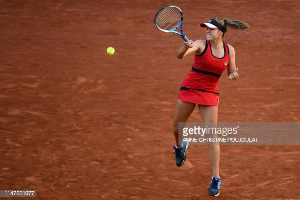 TOPSHOT Sofia Kenin of the US returns the ball to Serena Williams of the US during their women's singles third round match on day seven of The Roland...