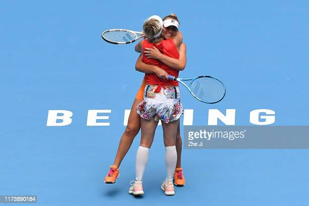 Sofia Kenin of United States and Bethanie Mattek-Sands of the United States celebrate after winning the Women's doubles final match against Jelena...