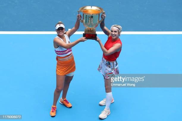 Sofia Kenin of United States and Bethanie MattekSands of the United States pose with the trophy during the medal ceremony after the Women's doubles...