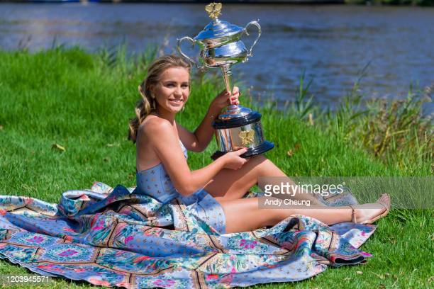 Sofia Kenin of USA poses for a photoshoot with Daphne Akhurst Memorial Cup and dressed by local designer Jason Grech at The Boatshed at Yarra River...