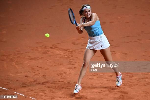 Sofia Kenin of USA returns a backhand on day 5 of the Porsche Tennis Grand Prix match between Anett Kontaveit of Estonia and Sofia Kenin of USA at...