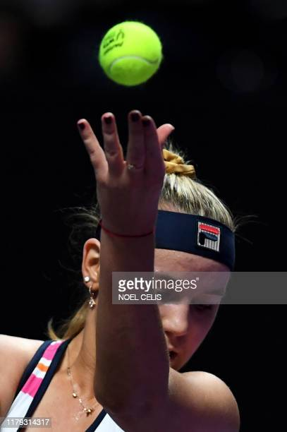 Sofia Kenin of USA serves the ball during her women's singles match against Elina Svitolina of Ukraine in the WTA Finals tennis tournament in...
