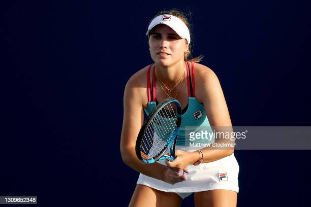 Sofia Kenin plays Ons Jabeur of Tunisia during the Miami Open at Hard Rock Stadium on March 28, 2021 in Miami Gardens, Florida.