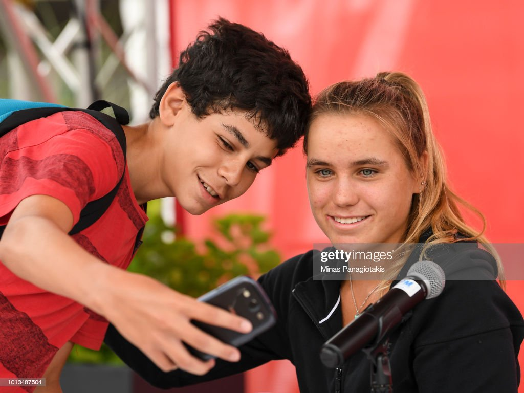 Sofia Kenin poses for a photo with a fan during day three of the Rogers Cup at IGA Stadium on August 8, 2018 in Montreal, Quebec, Canada.