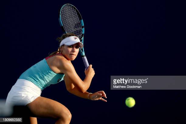 Sofia Kenin returns a shot to Ons Jabeur of Tunisia during the Miami Open at Hard Rock Stadium on March 28, 2021 in Miami Gardens, Florida.