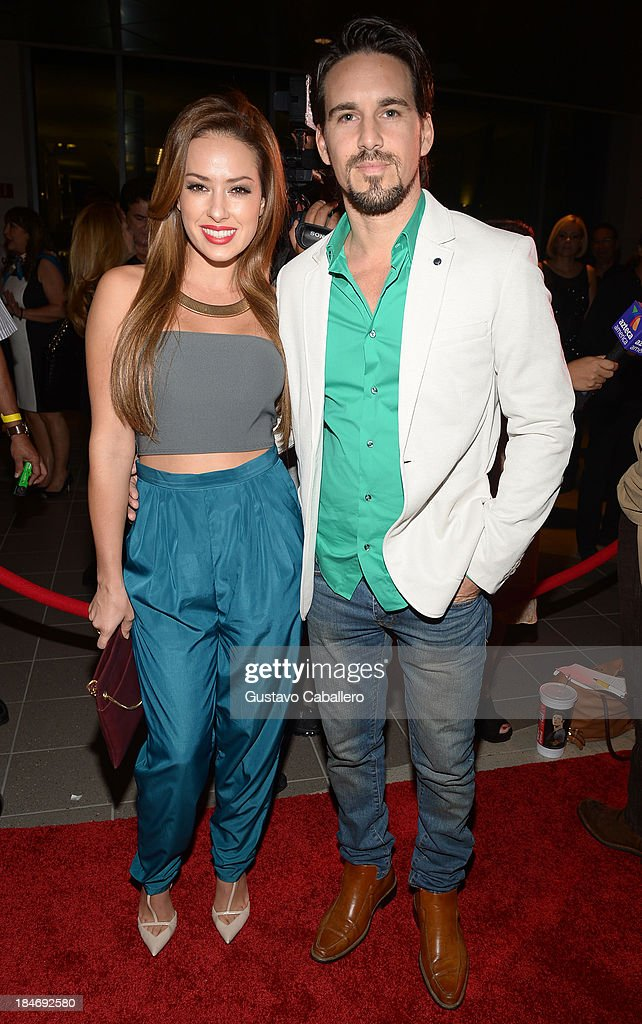 Sofia Lama and Leonardo Reyes arrives for the premiere of 'The Snitch Cartel' at Regal South Beach on October 14, 2013 in Miami, Florida.