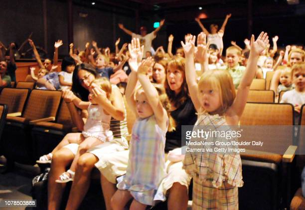 Sofia Lario 1 1/2 and her mother Elizabeth left Sarah Peterson with her mother Jennifer and Caitlyn Dennehy put their arms in the air following the...