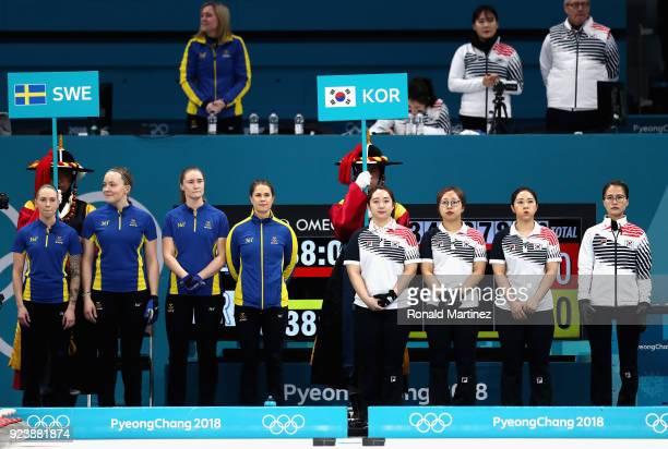 Sofia Mabergs Agnes Kochenhauer Sara McManus and Anna Hasselborg of Sweden line up with opponents YeongMi Kim SeonYeong KyeongAe Kim and EunJung Kim...
