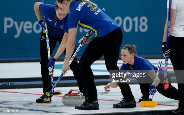 Sofia Mabergs of Sweden throws a stone helped by teammates Sara McManus and Agnes Knochenhauer during the women's curling semifinal game between...