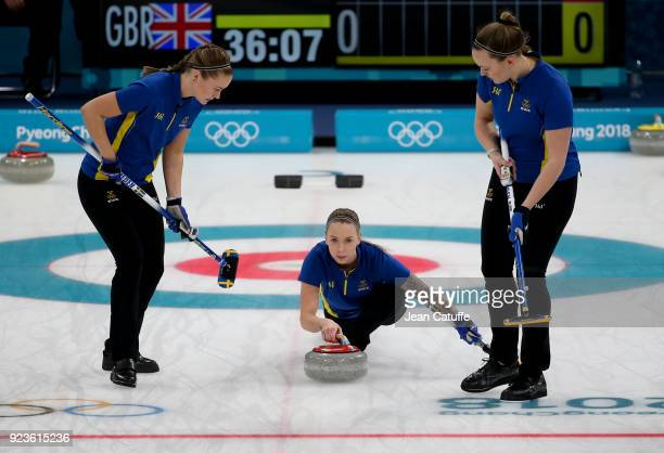 Sofia Mabergs of Sweden throws a stone surrounded by teammates Sara McManus and Agnes Knochenhauer during the women's curling semifinal game between...