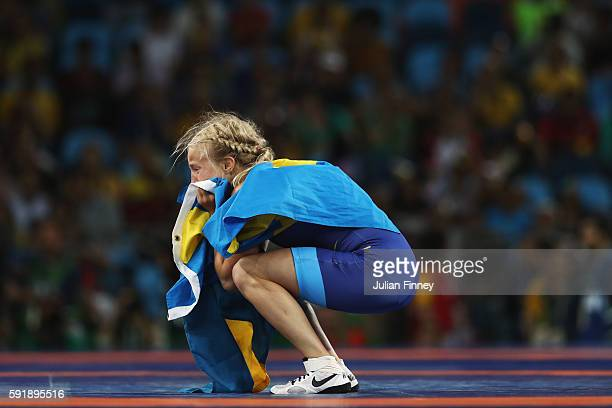 Sofia Magdalena Mattsson of Sweden celebrates after defeating Xuechun Zhong of China during the Women's Freestyle 53 kg Bronze medal match on Day 13...