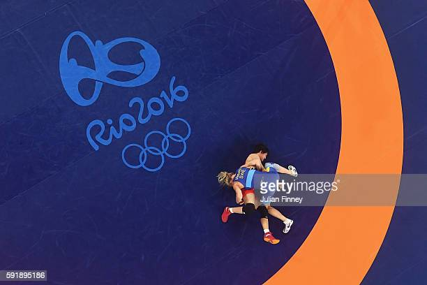 Sofia Magdalena Mattsson of Sweden competes against Xuechun Zhong of China during the Women's Freestyle 53 kg Bronze medal match on Day 13 of the Rio...