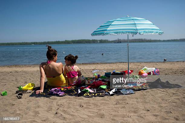 Sofia Martins and her 5-year-old daughter Vanessa sat on Cherry beach eating cherries and feeding birds. They refused to swim in the water that has...