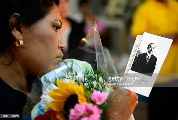 Sofia Miselem A woman looks at a leaflet bearing an image of late doctor Jose Gregorio Hernandez during a mass at the Holy Church of La Candelaria...