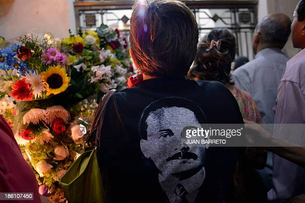Sofia Miselem A woman wearing a Tshirt with an image of late doctor Jose Gregorio Hernandez participates in a mass at the Holy Church of La...