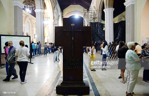 Sofia Miselem People attend mass at the Holy Church of La Candelaria where the remains of doctor Jose Gregorio Hernandez are kept in downtown Caracas...