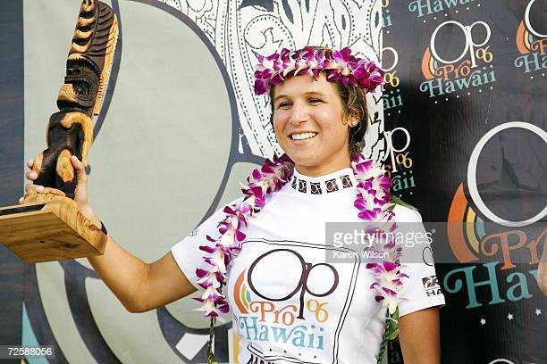 Sofia Mulanovich of Peru holds her trophy after winning the OP Pro World Qualifying Series on Ali'i Beach Park on November 16 2006 in Haleiwa Hawaii...