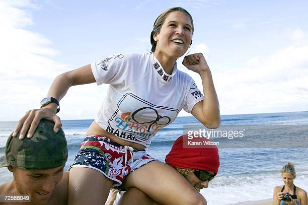 Sofia Mulanovich of Peru is carried on the beach after winning the OP Pro World Qualifying Series on Ali'i Beach Park on November 16 2006 in Haleiwa...