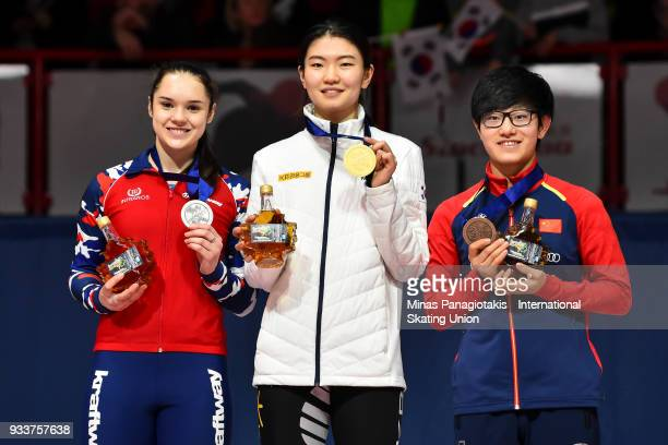 Sofia Prosvirnova of Russia Suk Hee Shim of Korea and Jinyu Li of China hold up their medals after competing in the women's 1000 meter Final during...